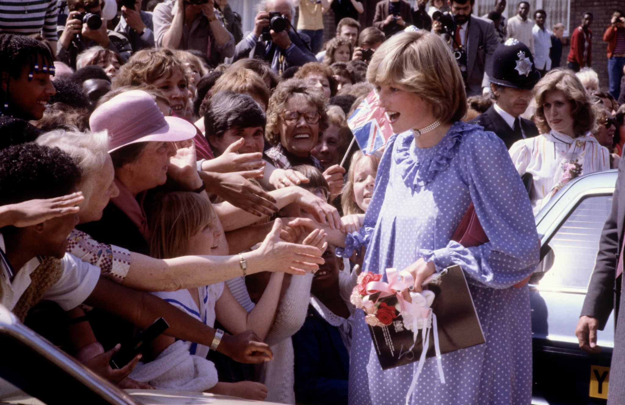 Princess Diana held hands with onlookers while opening a community center in London in May 1982 — her last official engagement before Prince William's birth.