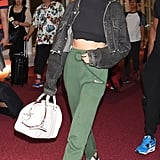 Fall staple: a cropped acid wash denim jacket. Selena wore it with: Vetements sweatpants, Converse sneakers, a Coach bag, and a black cropped turtleneck at the airport in Tokyo in August 2016.
