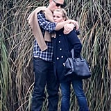 Reese Witherspoon and Jim Toth cuddled up on the sidelines at Deacon's soccer game in LA in December.