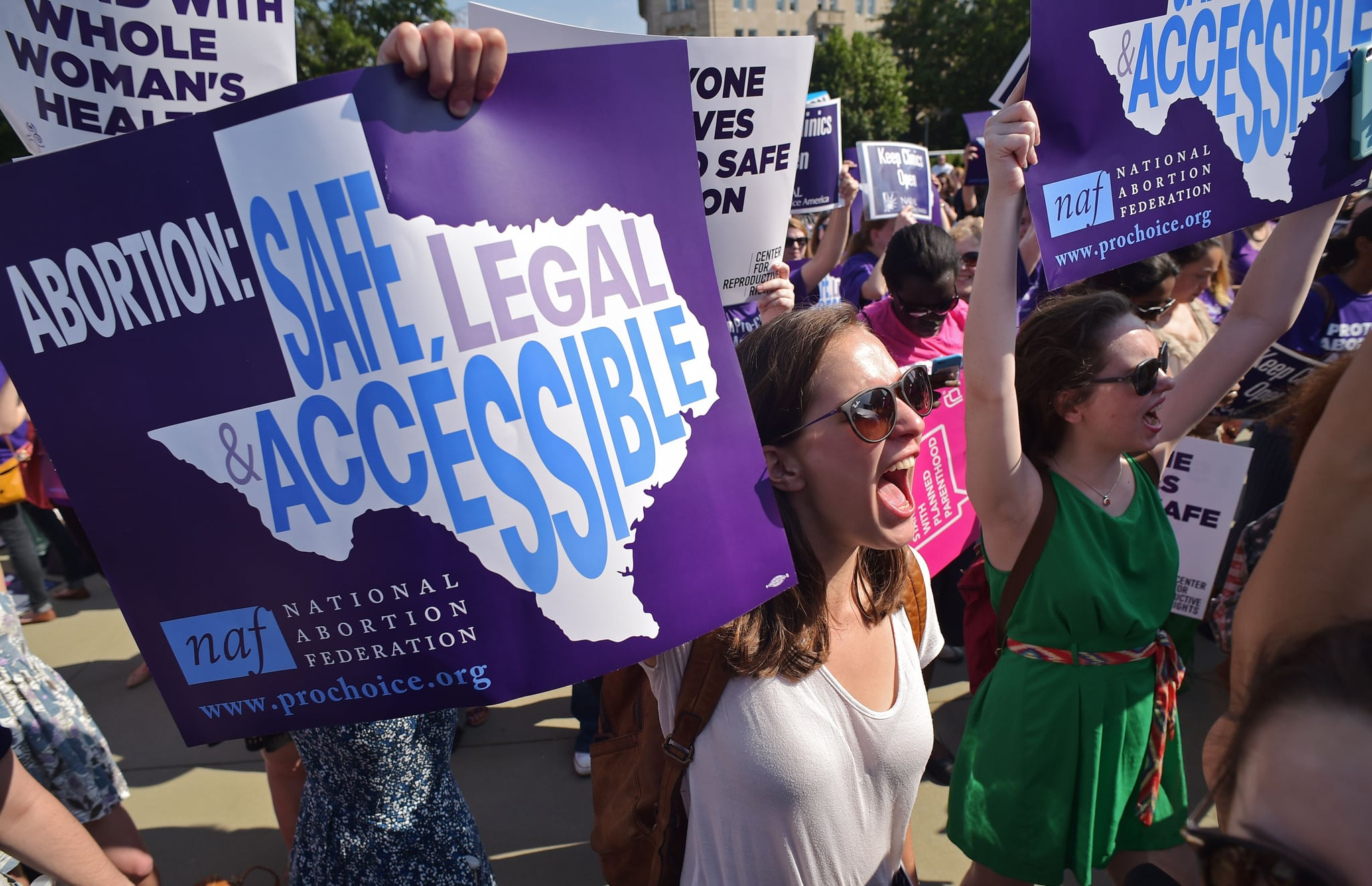 Abortion rights activists hold placards and chant outside of the US Supreme Court ahead of a ruling on abortion clinic restrictions on June 27, 2016 in Washington, DC.In a case with far-reaching implications for millions of women across the United States, the court ruled 5-3 to strike down measures which activists say have forced more than half of Texas's abortion clinics to close. / AFP / MANDEL NGAN        (Photo credit should read MANDEL NGAN/AFP via Getty Images)