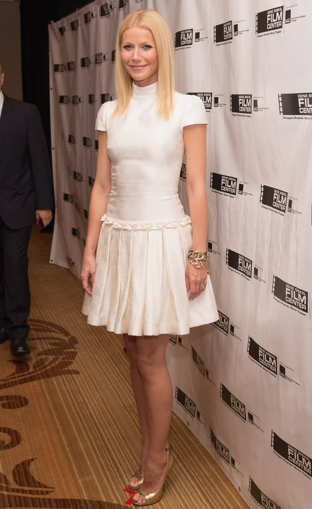 """Gwyneth Paltrow donned a white Alexander McQueen dress when she accepted the Renaissance Award at the 2013 Gene Siskel Film Center Gala in Chicago on Saturday. She flew out to the Windy City from London, where she has been staying with her family after wrapping up her big press tour for Iron Man 3 in May. On Thursday, Gwyneth showed PDA with Chris Martin during a low-key stroll in England. Her time in her home base hasn't just been about taking it easy, as she also took time out to sign an Audi to be auctioned off at Elton John's upcoming AIDS fundraiser. Coming up, Gwyneth will start preparations for her newest film, 33 días, which is set to begin production soon. The movie will follow Pablo Picasso, played by Antonio Banderas, as he completes work on his famous """"Guernica."""" Gwyneth will play Dora Maar, an artist that was in a relationship with Pablo during that time."""