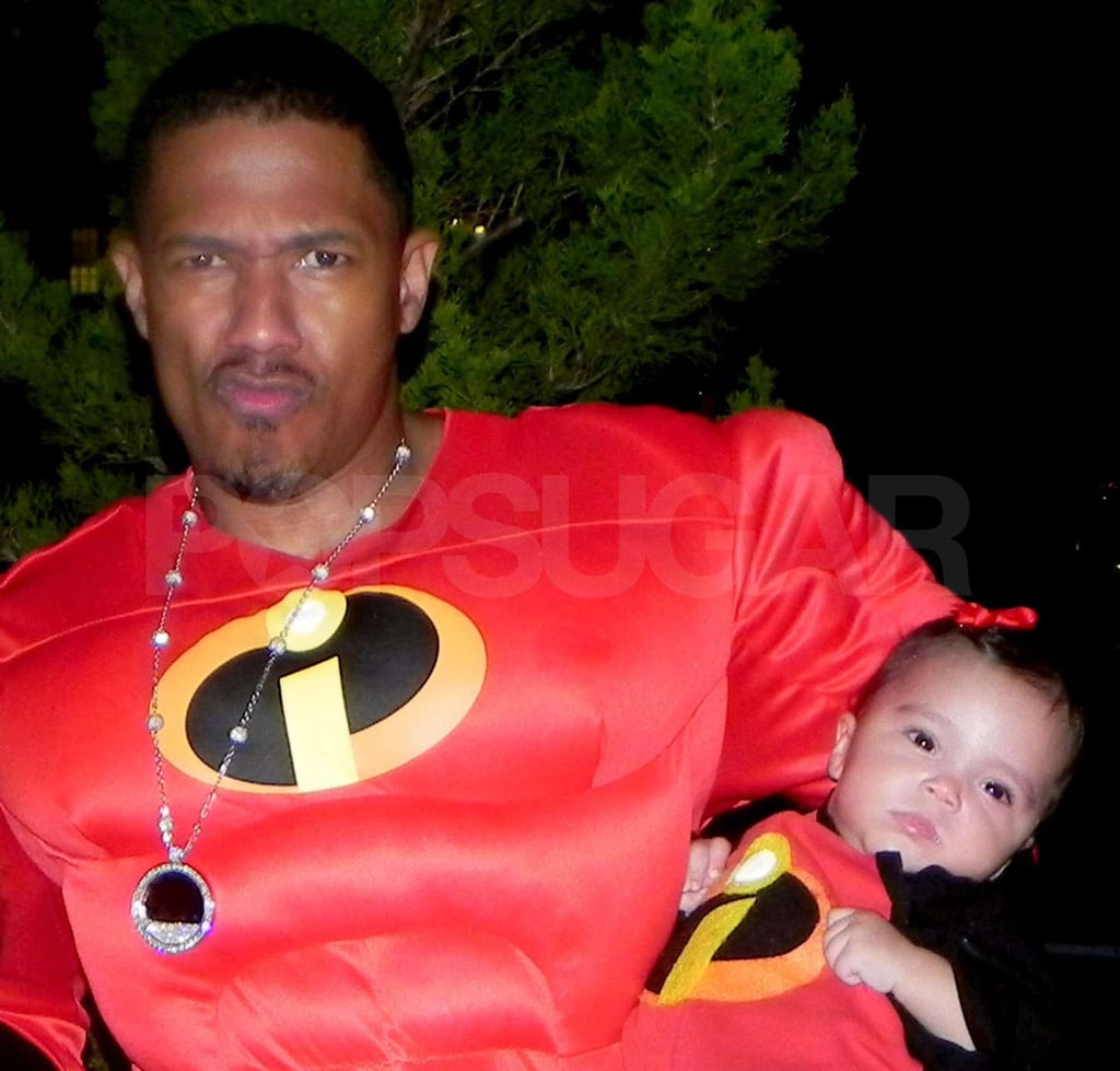 Nick Cannon holds onto Monroe in their Incredibles costumes.