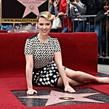 Scarlett Johansson posed with her star on the red carpet.