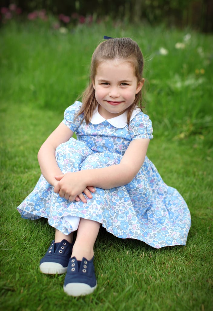 Princess Charlotte graced the world with her presence on May 2, 2015, and the little royal is growing up fast. Ahead of her fourth birthday this week, Kensington Palace released four precious new photos of Charlotte taken by her mom, Kate Middleton — the Duchess of Cambridge is known for photographing all three of her kids for special milestones, and most recently blessed us with a few insanely cute snaps of her youngest, Prince Louis, who turned one in April. Now, it's big sister's turn to shine!      Related:                                                                                                           Will and Kate Had a Rare Family Outing With George and Charlotte, and the Photos Are Too Cute!               In the portraits, our dear Lottie is showing off the latest in royal toddler fashion, sporting her signature floral dress and sneakers as well as a plaid skirt and sweater combo while climbing a fence and picking a flower. While her style is obviously on-point, I'm mostly struck by Charlotte's sly smile and the twinkle in her eye — there's something very reminiscent of Princess Diana in her expression, though I still maintain that she is the spitting image of her great-grandmother, the queen.  As a self-professed Princess Charlotte stan, the arrival of these official photos makes me feel like it's my birthday. Scroll through to see Lottie's latest portraits, then check out even more of her cutest pictures over the years.       Related:                                                                                                           20 Facts About Princess Charlotte That Will Make Her Your Favorite Royal