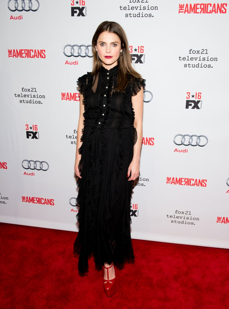 Keri Russell just got her hands on a special piece from the most buzzed-about label at the moment, Gucci. To attend a premiere for the fourth season of her FX show The Americans in New York on Saturday, the pregnant star hit the red carpet in a gorgous black chiffon gown.  She finished the look with a pair of serious shoes, Gucci's six-inch red leather Angel platform pumps ($990), and simple drop earrings and diamond rings. Kerri manages to look stunning whether she's keeping things simple or making new style rules, and her latest red carpet outing was another winner.