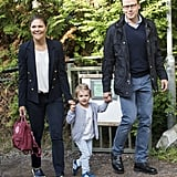 While taking her daughter to school, Princess Victoria ditched formal gowns for something a tad easier, styling a white tee with a structured navy jacket and slip-on sneakers.