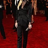 In her first red carpet outing since announcing her pregnancy, Jaime King opted to go the menswear-inspired route in a black Topshop suit with a black lace top. She completed her look with a Finn black diamond ring and a Dauphines of New York crown.