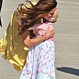 On a tour of Canada, Kate hugs a young cancer patient during an arrangement set up by the Make-a-Wish foundation.