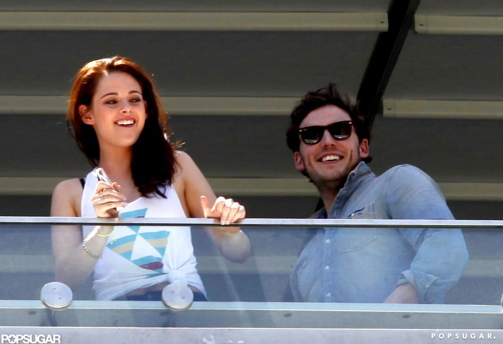 "Kristen Stewart hung out on the balcony of her Mexico City hotel with Snow White and the Huntsman costar Sam Claflin on Saturday. She was in town to promote the fairy-tale project at a photocall after doing press with Charlize Theron in London, Berlin, and Madrid. During an interview in the UK, Kristen read Fifty Shades of Grey out loud and cracked up at the racy novel. She also talked about Robert Pattinson's dog, Bear, calling him a ""baby"" and joking that he's ""literally a child."" Next up, Kristen will switch gears for her film On the Road, which premieres at the Cannes Film Festival on Wednesday."