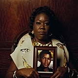 Sybrina Fulton holding a picture of Trayvon Martin