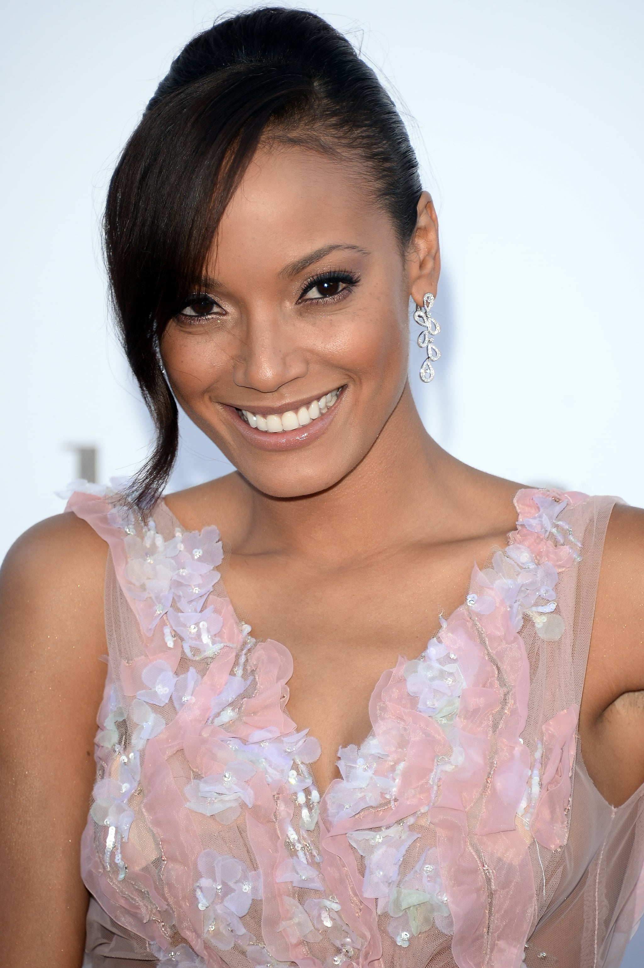 Sideswept bangs and a sleek French roll were the highlight of Selita Ebanks's amfAR look, while her makeup was au naturale.
