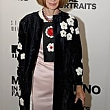 Anna Wintour wore a floral-embellished look from Prada's Spring '13 runway collection.