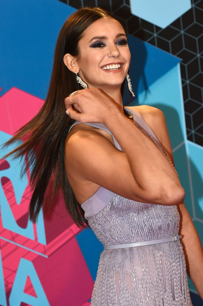 Nina Dobrev hit the red carpet at the 2016 MTV European Music Awards on Sunday looking exceptionally glamorous. Although we would have loved to see The Vampire Diaries star arrive in her hilarious horse costume, she opted for a gorgeous, beaded lavender gown that shimmered as she made her way down the carpet. Nina looked relaxed and carefree as she graciously stopped to snap a few selfies with fans and posed for photographers, before heading inside the Ahoy Arena in Rotterdam, Netherlands to see performers like Bruno Mars and The Weeknd do their thing.      Related:                                                                                                           Nina Dobrev Glows on the Red Carpet Following the Premiere of The Vampire Diaries