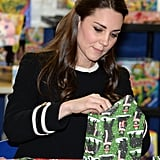 In 2014, during a visit to the Northside Center for Child Development in NYC, Kate Middleton helped wrap Christmas gifts with kids and teachers.