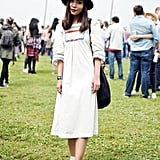 This cool vintage dress got a modern update with a black Urban Outfitters hat and platform Converse.