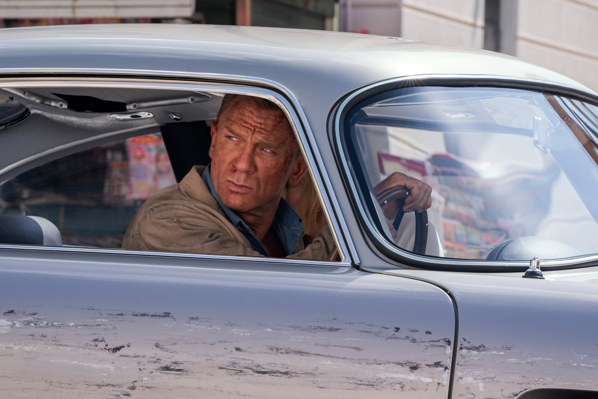 B25_31842_RC2James Bond (Daniel Craig) and Dr. Madeleine Swann (Léa Seydoux)drive through Matera, Italy in NO TIME TO DIEan EON Productions and Metro Goldwyn Mayer Studios filmCredit: Nicola Dove© 2020 DANJAQ, LLC AND MGM.  ALL RIGHTS RESERVED.