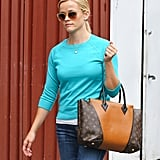Reese Witherspoon carried a Louis Vuitton bag.