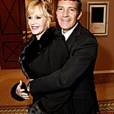 Antonio Banderas gave Melanie Griffith a hug at a dinner honoring Jeffrey Katzenberg at CinemaCon in Las Vegas.
