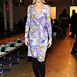 Leigh Lezark brightened up the Costello Tagliapietra show in a colorful drape-front dress by the designer, then tempered her bold hues via black opaque tights and black booties.