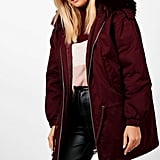 In rich burgundy, the Boohoo Niamh Faux Fur Hood Parka ($96) hits a sophisticated note.