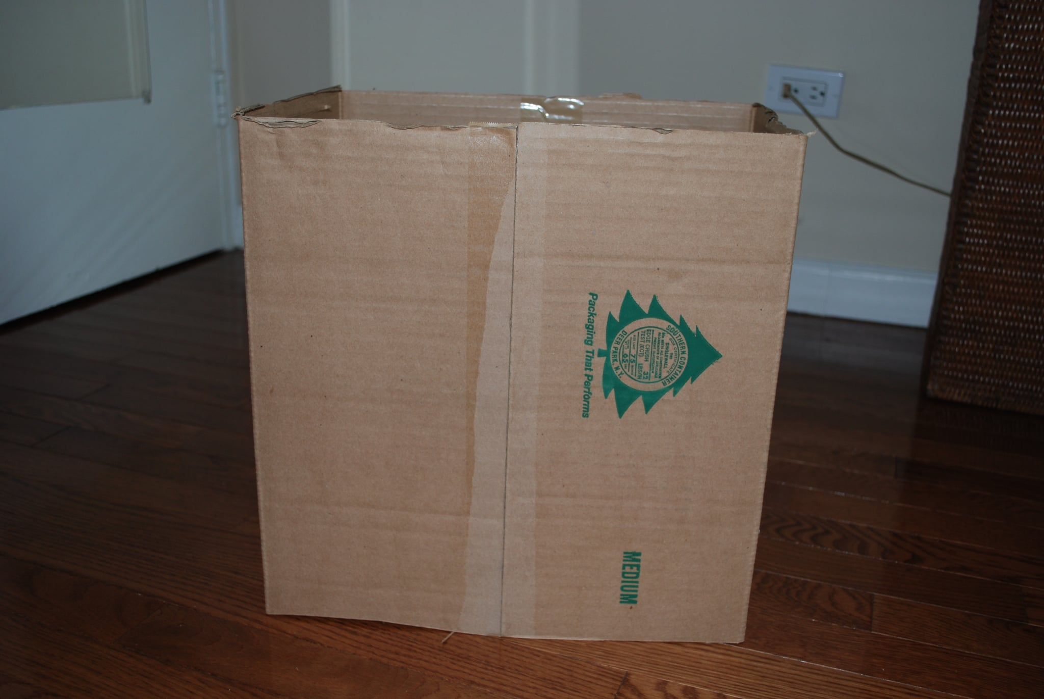 First, turn the box on its side and cut off the top and bottom of the box.  If the box seems to lose its structure, reinforce it