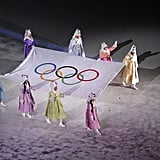 The official Olympic flag is carried into the stadium.