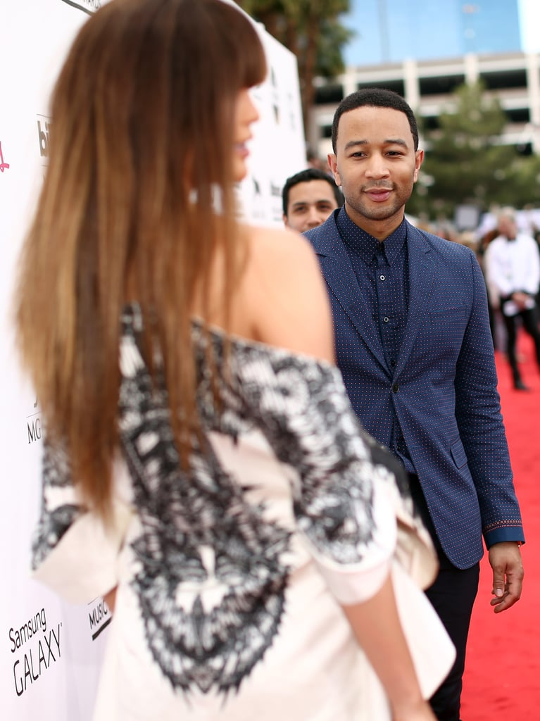 John looked stunned by his wife's beauty as she posed for photos at the Billboard Music Awards in May 2014.