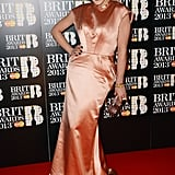 Rita Ora glowed in a silky peach Ulyana Sergeenko gown and plenty of sparkly baubles, including a custom-made Jennifer Fisher snake ring, at the 2013 Brit Awards.