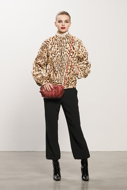 Leopard Goat Hair Bomber ($1,995), Crepe Black Elastic Bottom Pant ($595), Follow Me Black Patent Mid-Calf Boot ($995), Sunset Watersnake Red Cross Body Bag ($625) Photo courtesy of Tamara Mellon