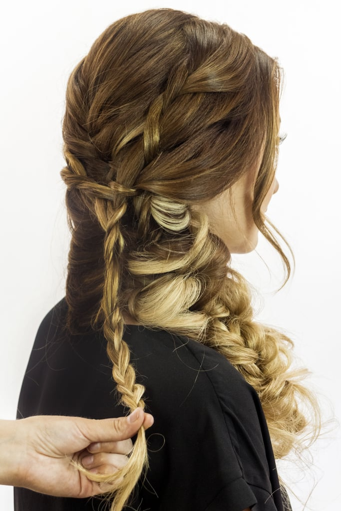 Continue plaiting your combined french braids until you run out of hair, and fasten it with an elastic.