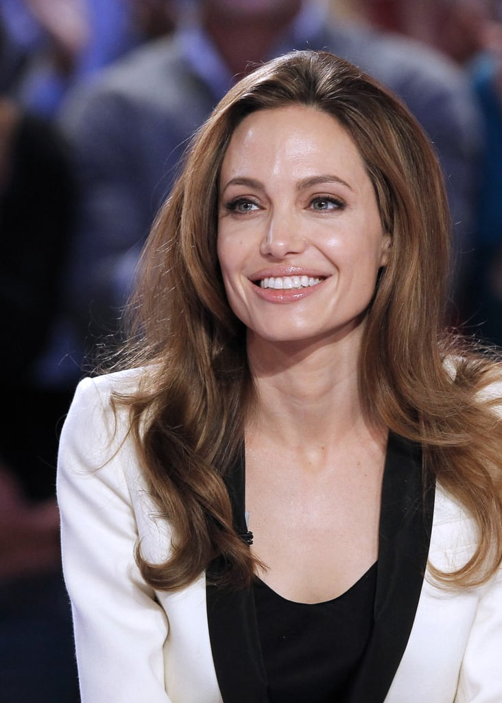 The panel of hosts spoke to Angelina in French.