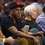 Jay-Z watched the game while his wife, Beyoncé, enjoyed a beverage.