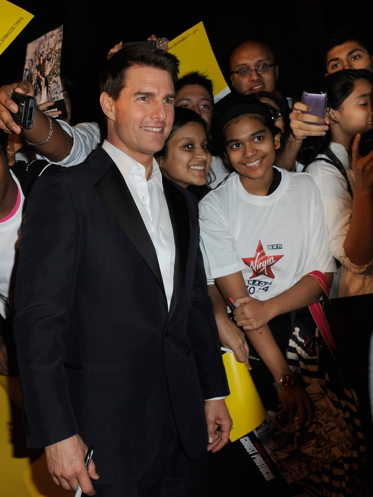 Tom Cruise was surrounded by happy fans in Dubai.
