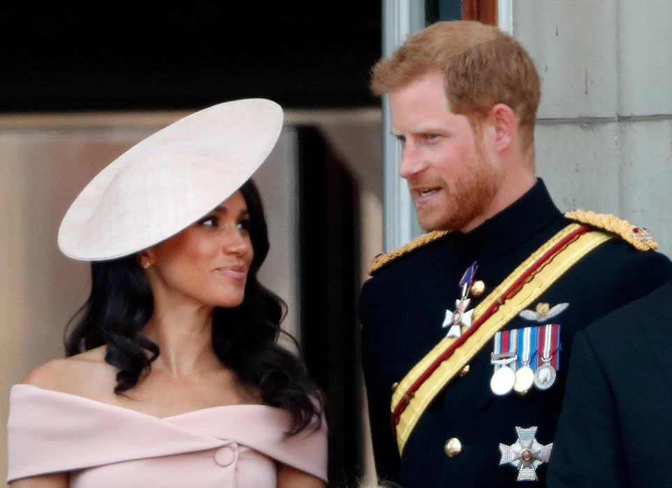 LONDON, UNITED KINGDOM - JUNE 09: (EMBARGOED FOR PUBLICATION IN UK NEWSPAPERS UNTIL 24 HOURS AFTER CREATE DATE AND TIME) Meghan, Duchess of Sussex and Prince Harry, Duke of Sussex stand on the balcony of Buckingham Palace during Trooping The Colour 2018 on June 9, 2018 in London, England. The annual ceremony involving over 1400 guardsmen and cavalry, is believed to have first been performed during the reign of King Charles II. The parade marks the official birthday of the Sovereign, even though the Queen's actual birthday is on April 21st. (Photo by Max Mumby/Indigo/Getty Images)