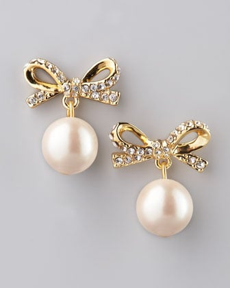 These Kate Spade Skinny Mini Faux-Pearl Drop Earrings ($58) provide a girlie, festive finish.