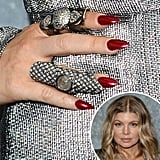 While attending Emporio Armani's fashion show in Milan earlier this year, Fergie decided on a sparkling crimson lacquer.