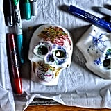 For an easy (and kid-friendly) option, decorate your sugar skulls with (nonedible) glitter and paint pens.
