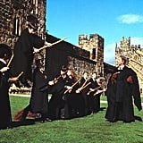 Here's Neville before his broomstick takes him for a disastrous ride in Harry Potter and the Sorcerer's Stone. The only big changes from the real Alnwick Castle in this scene is the CGI Quidditch field they added in the background and the statue that Neville's robe gets caught on was a prop meant to replicate the real statues on the top of the castle.