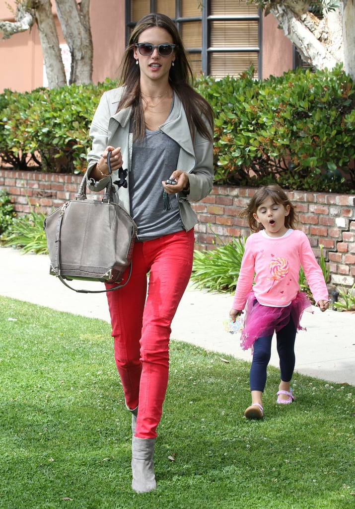 While paying a visit to the doctor, Alessandra Ambrosio kept her top half and Alexander Wang bag neutral but really punched things up on bottom with her red skinny jeans.