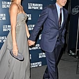 George Clooney and Stacy Keibler holding hands at the Paris premiere of The Descendants.