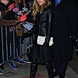 Here, Jennifer showcased an all-leather look, including a black Hervé Léger by Max Azria coat, with a contrasting white studded Valentino clutch. Follow suit by wearing head-to-toe black — it need not be Jennifer's exact look — then add a white bag, studded or not, for a fresh finish.