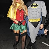 Paris Hilton and River Viiperi as Robin and Batman