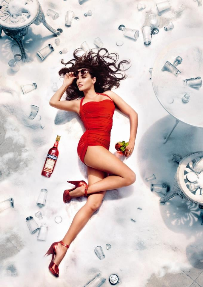 She posed in a red one-piece swimsuit for Campari's superstition-themed 2013 calendar. Source: Campari