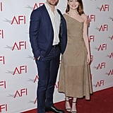 Emma Stone walked the red carpet in a simple one-shouldered design (and with Ryan Gosling at her side) at the AFI Awards.