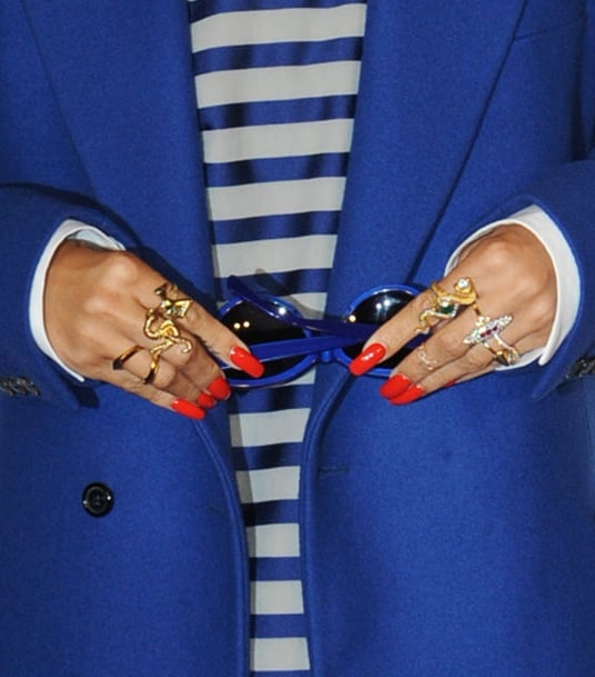 Gold rings and red nails added a cool-girl touch to her outfit ...