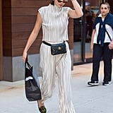 Kendall's slinky, silvery two-piece set was broken up by her Chanel waist bag.
