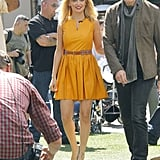 For her stint on Extra, Nicole sported a marigold Thakoon dress with a Navajo-inspired belt and House of Harlow platforms.       Pumps by House Of HarlowRings by House Of Harlow