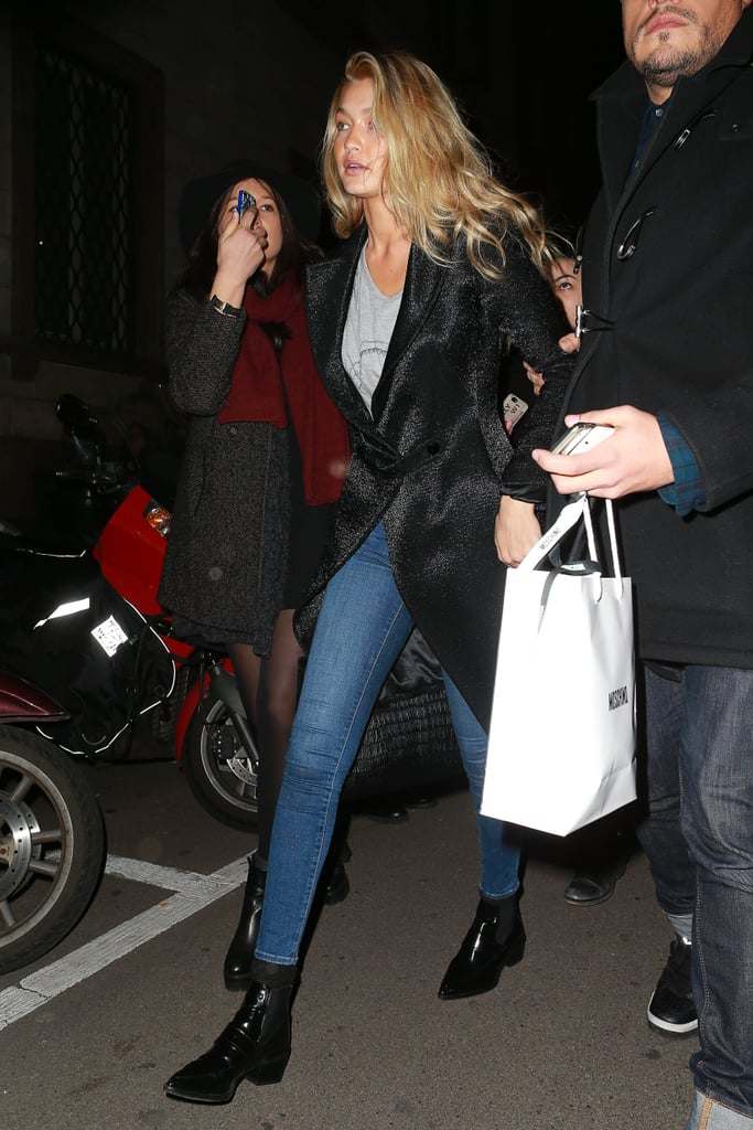 Wearing skinny jeans by A Gold E, a gray t-shirt, and a furry coat, completing the look with black booties.