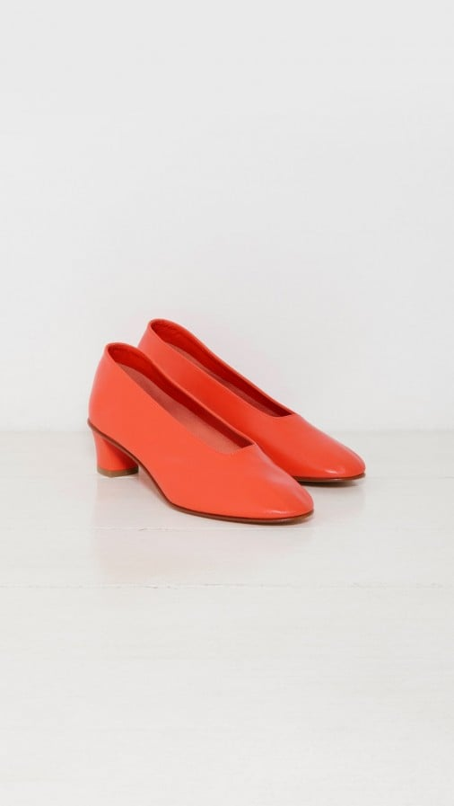 Martiniano's High Glove Pump ($580) is available in this tangy shade and features a signature Italian silhouette.