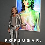 Kate Moss posed next to a topless photo of herself.